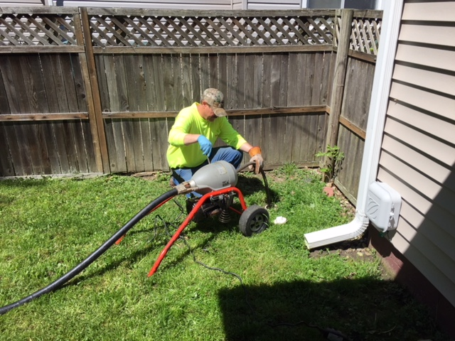 A plumber inspecting a line
